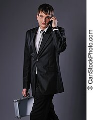 Young businessman talking on mobile phone