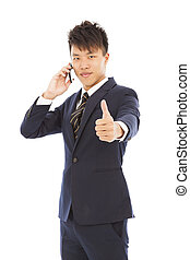 young businessman talking on the phone with thumb up