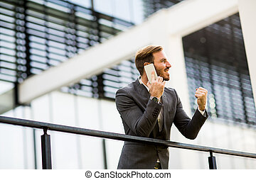 Young businessman talking over the phone