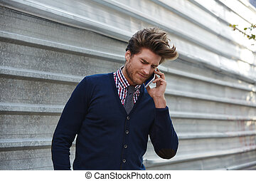 Young businessman talking smartphone phone