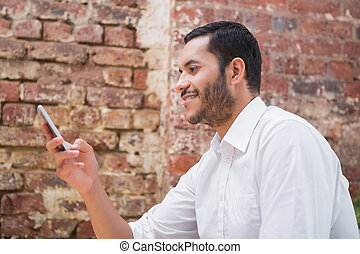 Young businessman text messaging