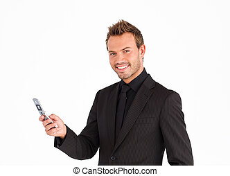 Young businessman texting and smiling at the camera -...