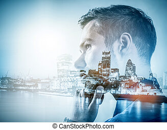 Young businessman thinking. Double exposure city background.