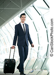 Young businessman traveling with bag