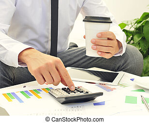 young businessman using a calculator