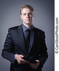 young businessman using a digital tablet
