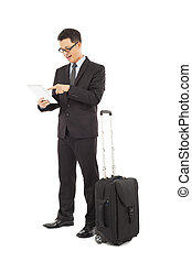 Young businessman using a tablet  with briefcase