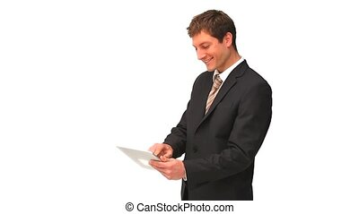 Young businessman using a touch pad isolated on a white...