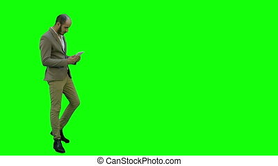 Young businessman using digital tablet on a Green Screen, Chroma Key.