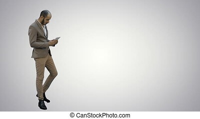 Young businessman using digital tablet on white background.