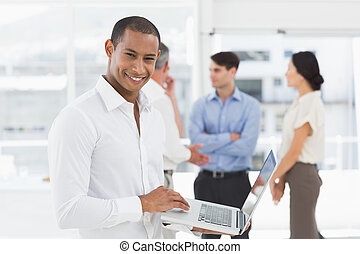 Young businessman using laptop with