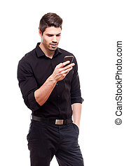 Young businessman using smartphone.