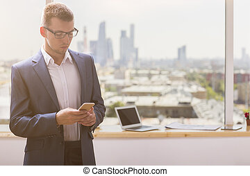Young businessman using smartphone