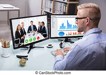 Businessman Video Conferencing With His Colleague