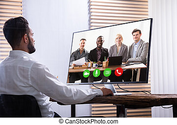 Businessman Video Conferencing With His Partner On Computer