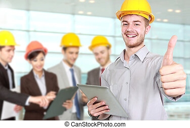 Young businessman wear a safety helmet showing thumb up