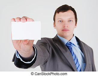 Young businessman with a business card