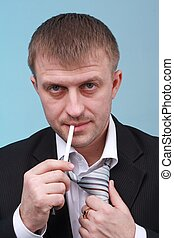 young businessman with a cigarette