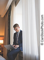 Young businessman with a laptop