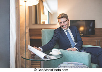 Young businessman with a newspaper