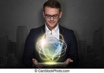 Young businessman with a tablet on his hand