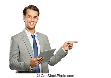 Young businessman  with a tablet pc, doing a presentation, isola