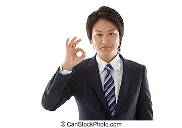 Young businessman with an OK sign