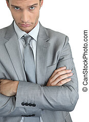 Young businessman with arms crossed
