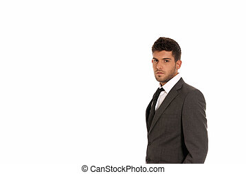 Young businessman with copy-space looking serious isolated on white background