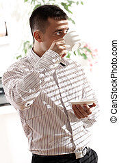 Young businessman with cup of coffee