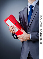 Young businessman with folders