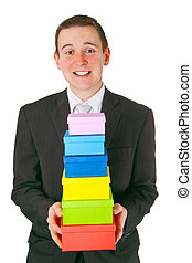 Young businessman with gift boxes