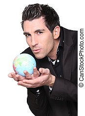 young businessman with globe in his hands