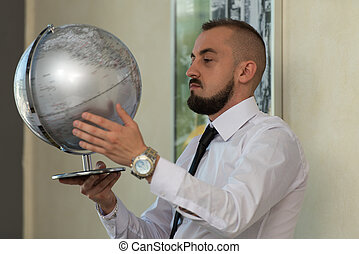 Young Businessman With Globe
