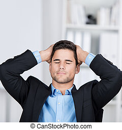 Young businessman with hands on his head