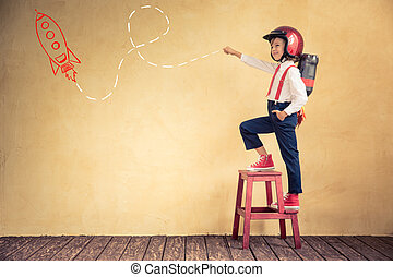 Young businessman with jetpack - Portrait of young...