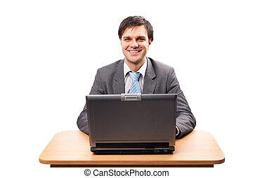Young businessman with laptop at his desk