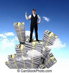 Young businessman with money symbols against blue skyy...