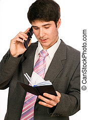 Young businessman with phone and diary