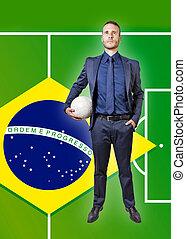 businessman with soccer ball on a brazil flag