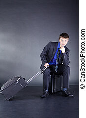 young businessman with suitcase