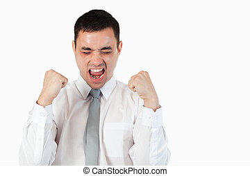 Young businessman with the fists up against a white...