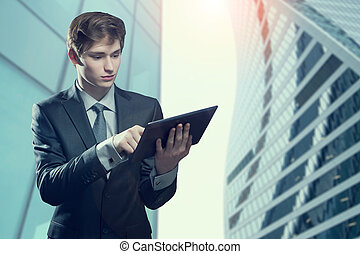 Young businessman with touch screen computer