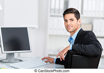 Young businessman working at his computer