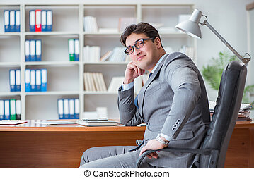 Young businessman working in the office