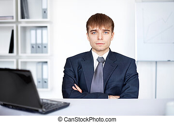 young businessman working on laptop in office