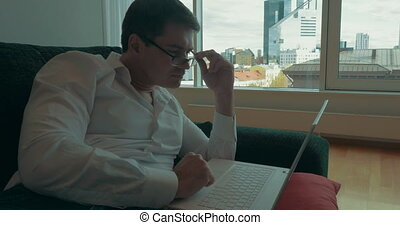 Young businessman working with laptop at home