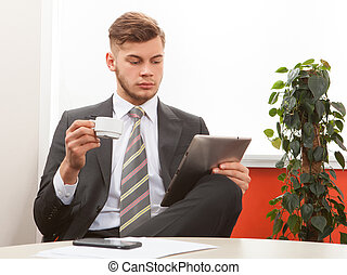 young businessman working with tablet