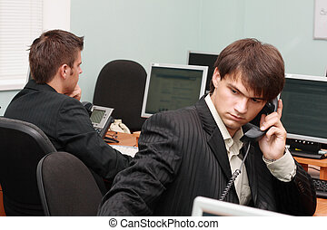 Young businessmen in office