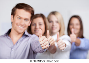 Young Businesspeople Showing Thumbs Up Sign